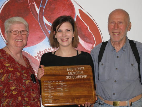 Alyssa Irvin poses with Julie and Robert Fritz, parents of Erich Fritz.