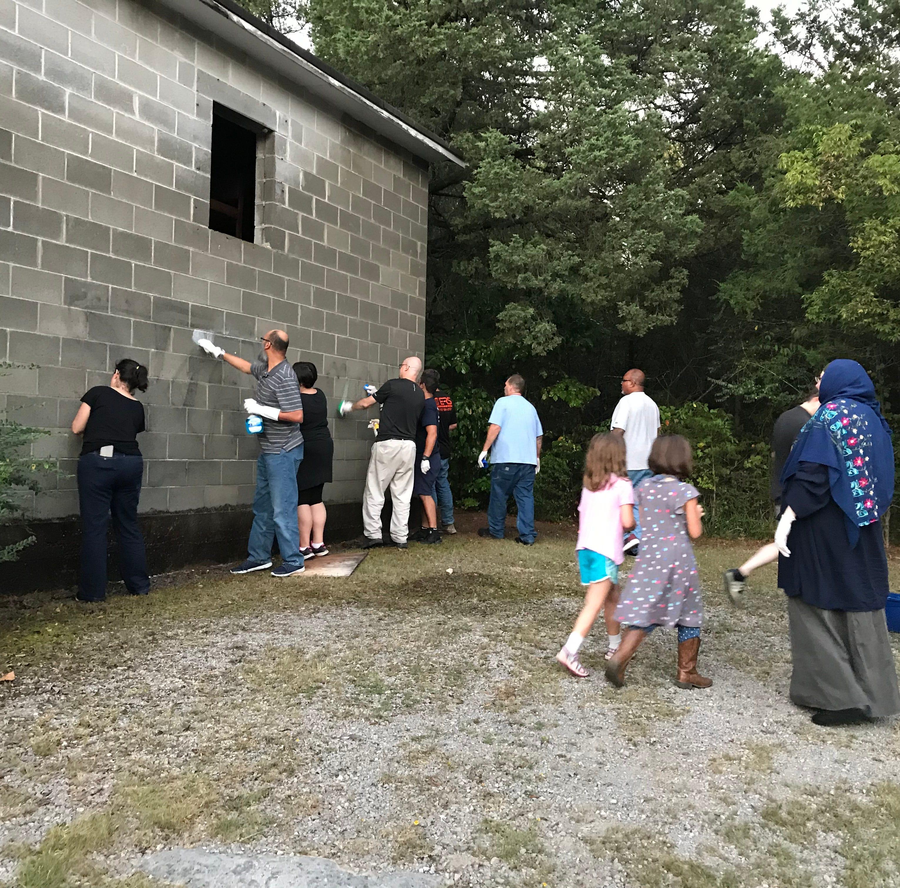 Murfreesboro community gathers to clean 'white power' vandalism at predominantly black church