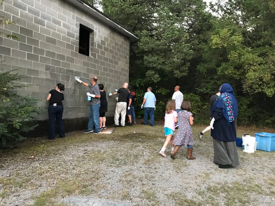 Walnut Grove Baptist Church in Murfreesboro was vandalized with racist graffiti on Sept. 18. Area residents from all walks of life gathered to help clean the church the next day.