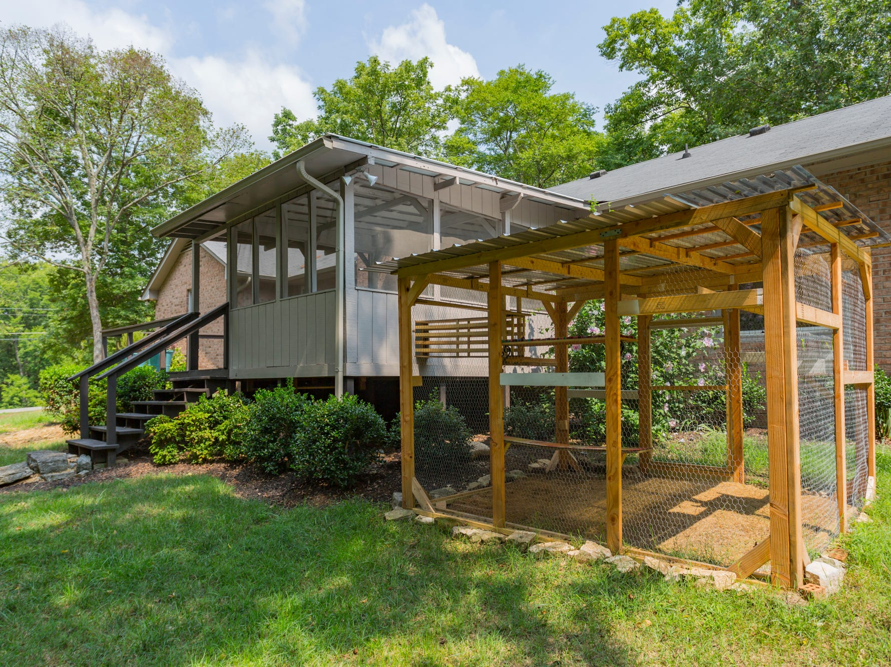 Just off the screened in porch sits a chicken coop. According to the real estate listing of this home, chickens are allowed in the city of Brentwood.