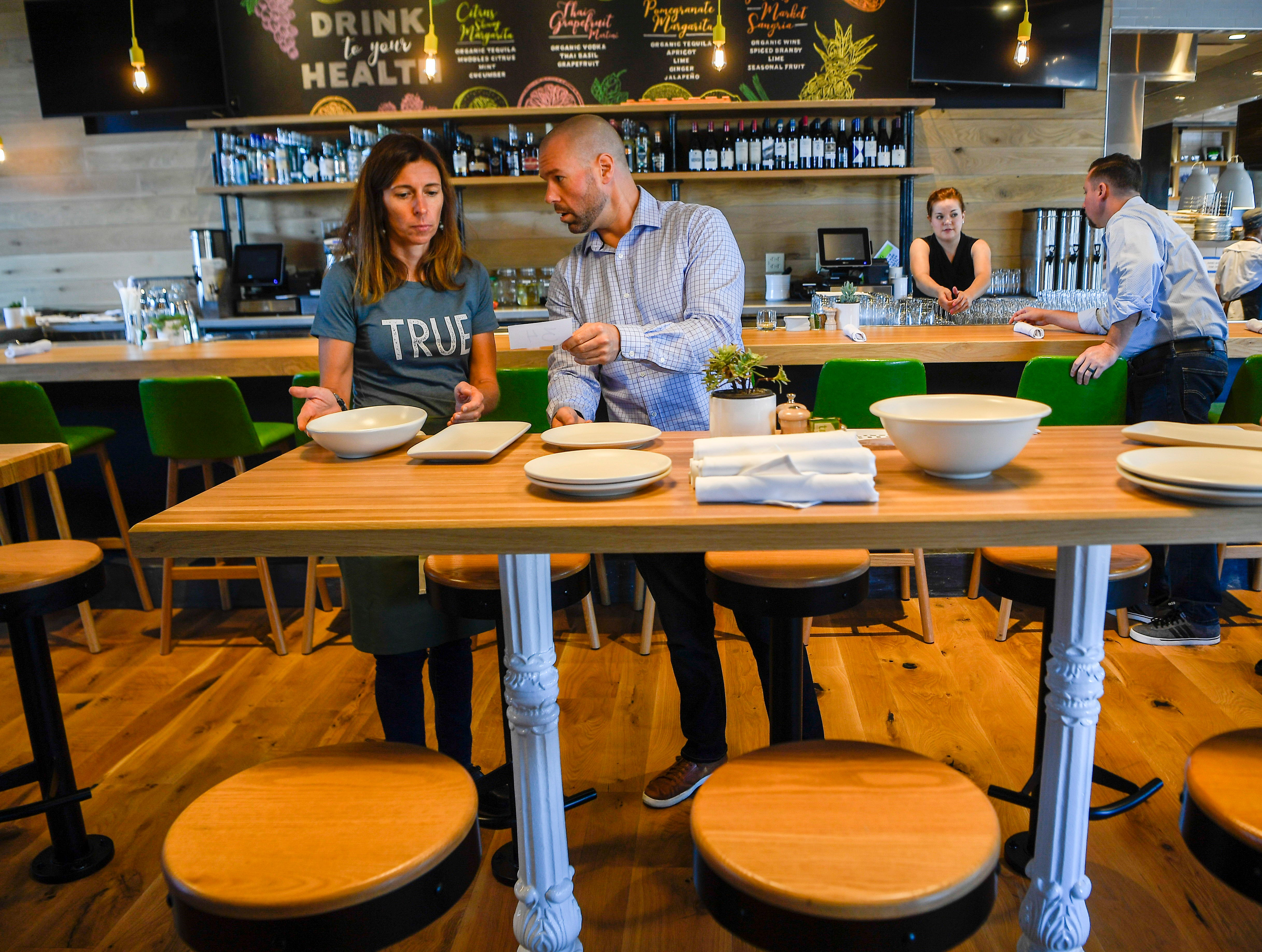 Mike Perrin, right, instructs Jackie Tulumaris during training at the new True Food Kitchen in Green Hills on Thursday, Sept. 20, 2018.