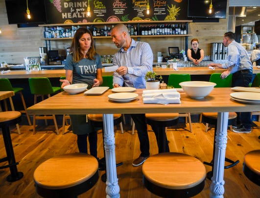 mike perrin right instructs jackie tulumaris during training at the new true food kitchen - True Food Kitchen