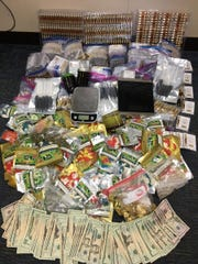 Metro police found 2,348 vials of THC oil, 75 packages of THC edibles and $3,080 in cash while executing a search warrant.