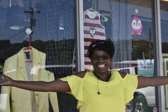 Libby Brown smiles in front of L & K Bargain Hunt, located at 202 N. Main St. in Ashland City.