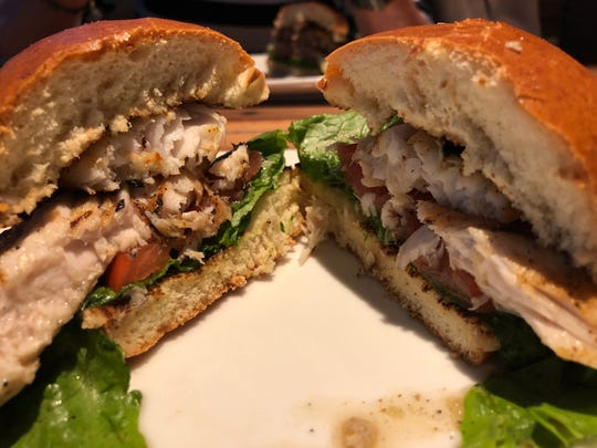 The Mahi Mahi sandwich is served juicy and hot with two large pieces of fish.