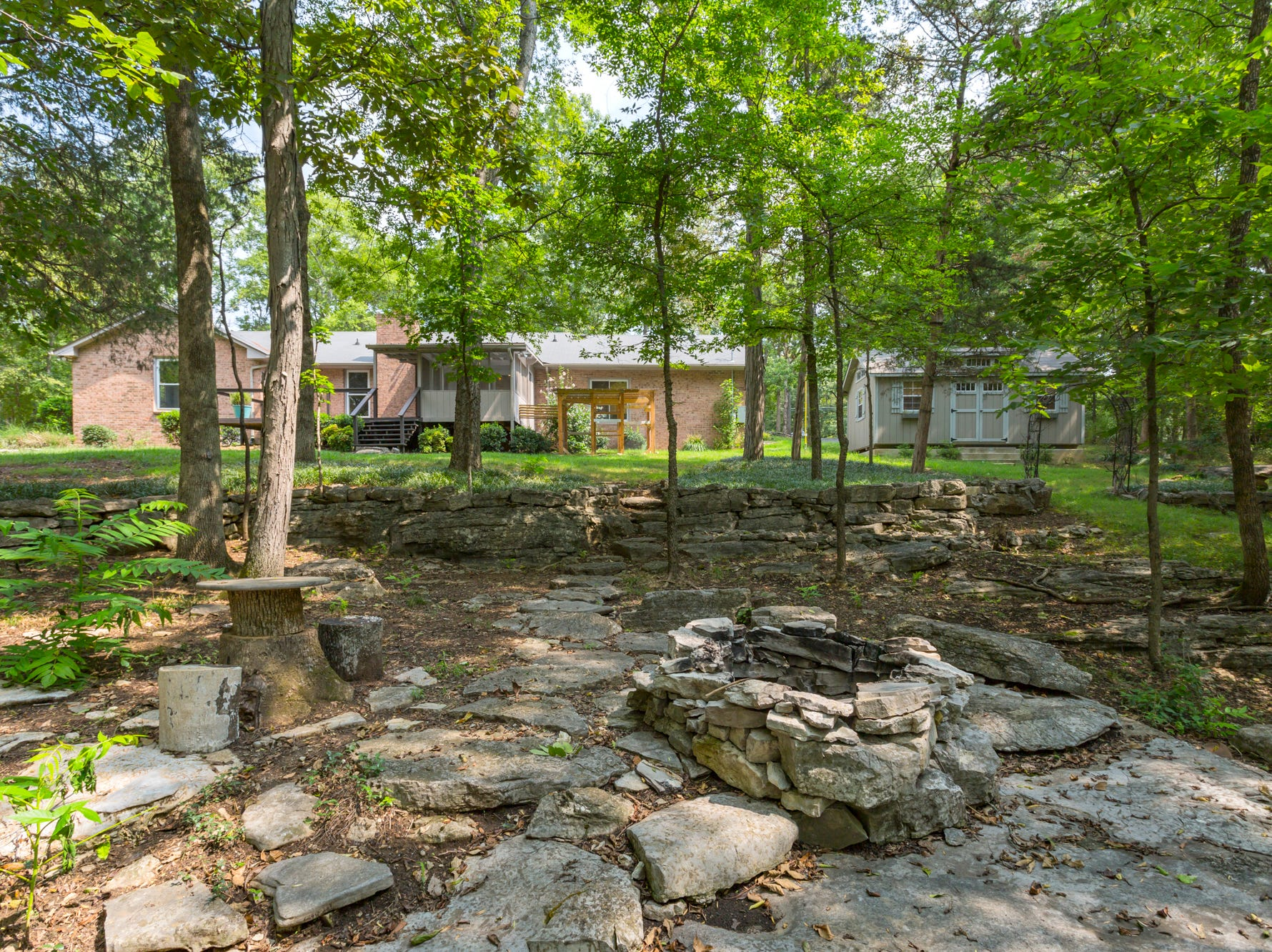 This home sits on nearly a one-acre lot that is wooded and private with its own fire pit.