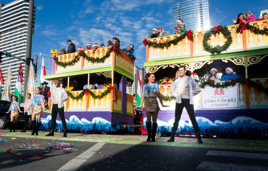 dancers pose in front of the monroe carell jr childrens hospital at vanderbilt float in - When Is The Christmas Parade