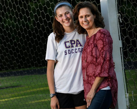 CPA soccer player Caroline Betts has scored seven consecutive hat tricks, scoring 28 goals in 10 games for the unbeaten Lady Lions stands with her mother Holly Betts who was recently diagnosed with breast cancer. photographed at Christ Presbyterian Academy Wednesday, Sept. 19, 2018, in Nashville, Tenn.