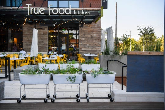 Outdoor garden basins on the partially covered patio at True Food Kitchen in Green Hills have fresh herbs and spices growing.