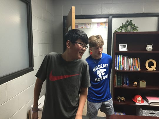 West Wilson Middle School football team manager Aiden Atkins, left, and wide receiver and free safety Sean Aldridge, right.