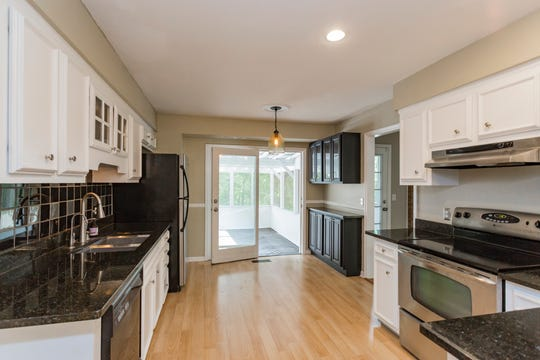 The kitchen leads out to the screened-in porch.