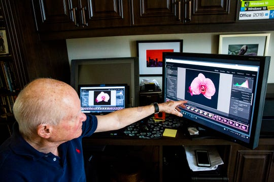 Morris Herstein explains his post-production process in his workspace at his home in Naples on Thursday, Sept. 20, 2018.