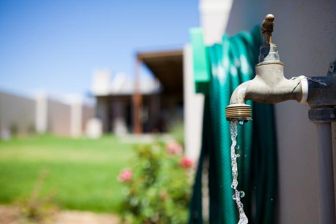 Water running from a garden tap.