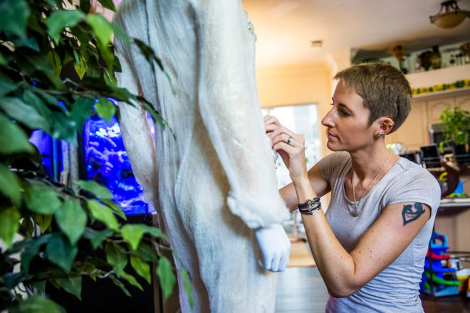 Lauren Osborne, mother of three, works on her halloween costume in her Golden Gate Estates home on Thursday, Sept. 20, 2018. She has been working on her costume since July. Osborne's family will be dressing in a Ghostbusters theme for Halloween.