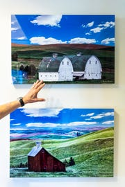 Morris Herstein discusses two photographs of barns that hang in his home in Naples on Thursday, Sept. 20, 2018.