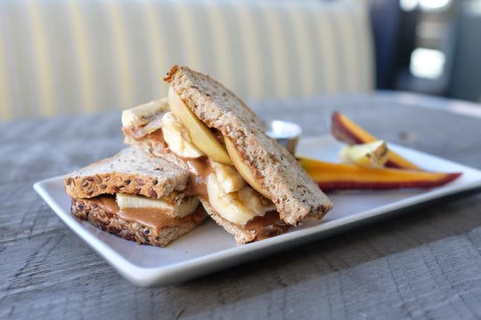 An almond butter, banana and apple sandwich on the kids' menu at True Food Kitchen in North Naples.