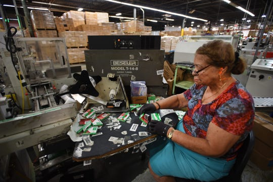Theresa Rodriguez, packer, puts staples in the final packages on the assembly line at Arrow Fastener in Saddle Brook on Sept. 20, 2018.