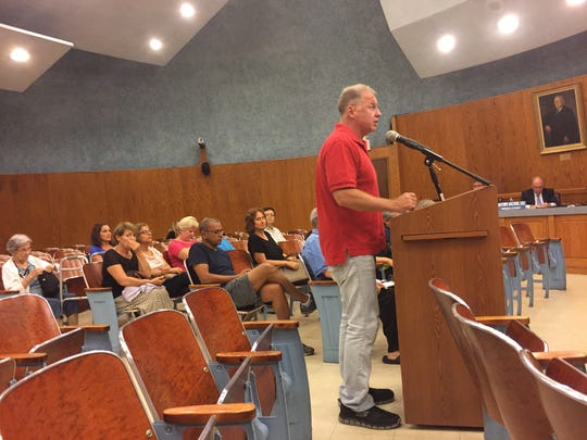 Bill Brennan, a retired firefighter from Wayne, demands answers from officials about the township's involvement in the development of Brittany Chase.