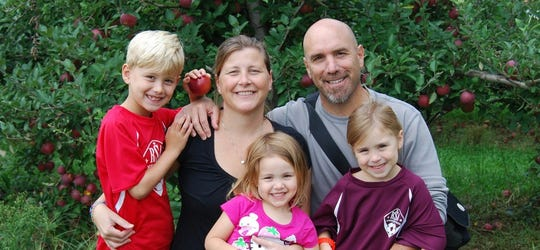 Kerrie Prettitore, center, with her husband, Glenn, and children Liam, Maeve and Fiona. The Ridgewood woman had a rare genetic condition known as DPD deficiency that caused a severe toxic reaction to the chemotherapy drug, 5-FU, used to treat colon cancer. She died in 2018, four years after her first and only chemotherapy treatment. Her husband is advocating for a law to require doctors who prescribe 5-FU to offer their patients a screening test for DPD deficiency.