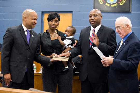 Mayor Richard Mola swore in Police Officer Michael Johnson in 2014. His wife Lakisha, son, Jonathan, and Assemblyman Benji Winberly were holding the bible.