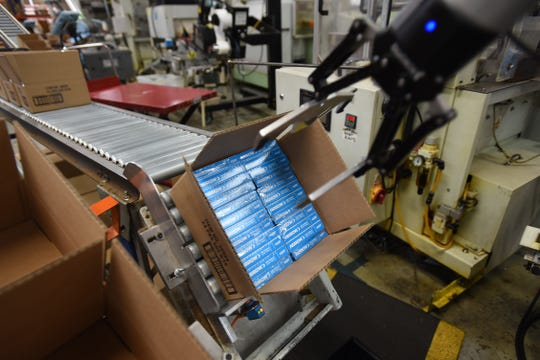 A machine loads packages of staples into cartons at the stapler assembly line at Arrow Fastener in Saddle Brook.