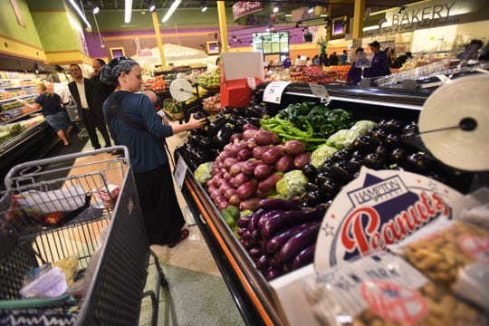 A shopper at the Seasons in Clifton on opening day.