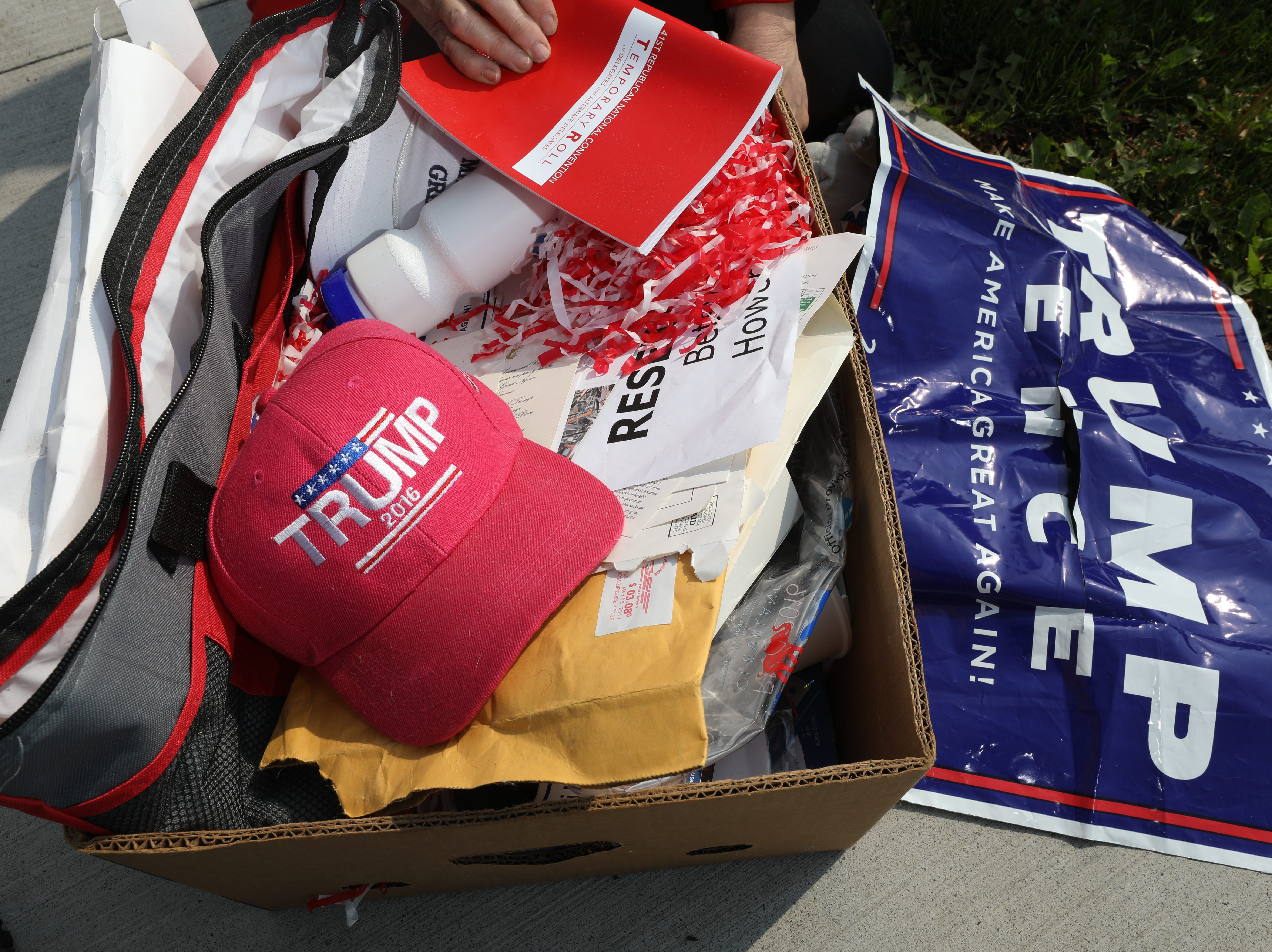"Elizabeth ""Betsy"" Hower, chair of the Adams County Republican Committee, shows off her Trump signs and memorabilia that she had gotten at the 2016 Republican convention at the entrance to the town of Gettysburg, the Adams County seat."