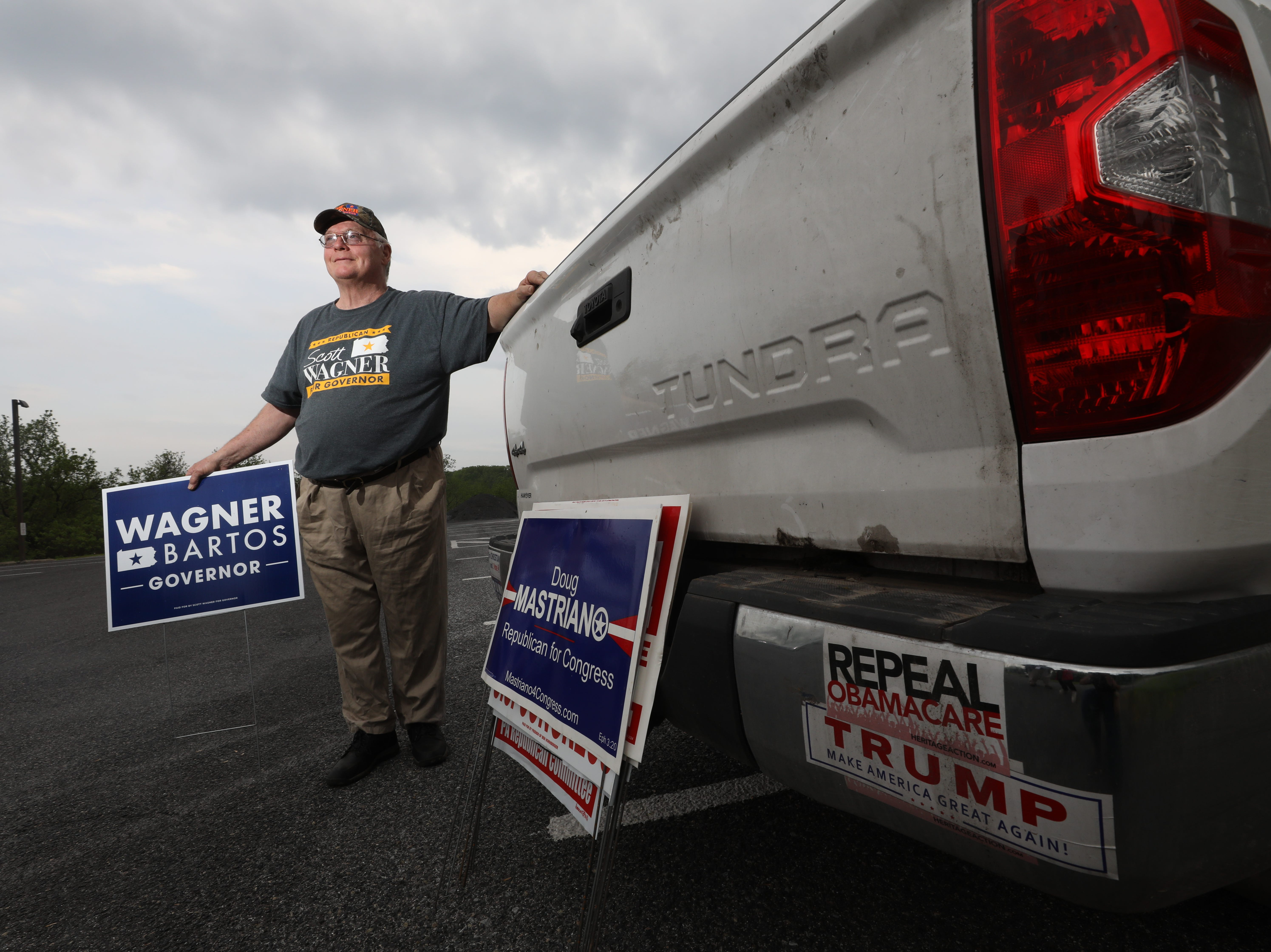Donald Trump supporter John Longanecker spent his evening putting out campaign signs the day before the Pennsylvania Primary.