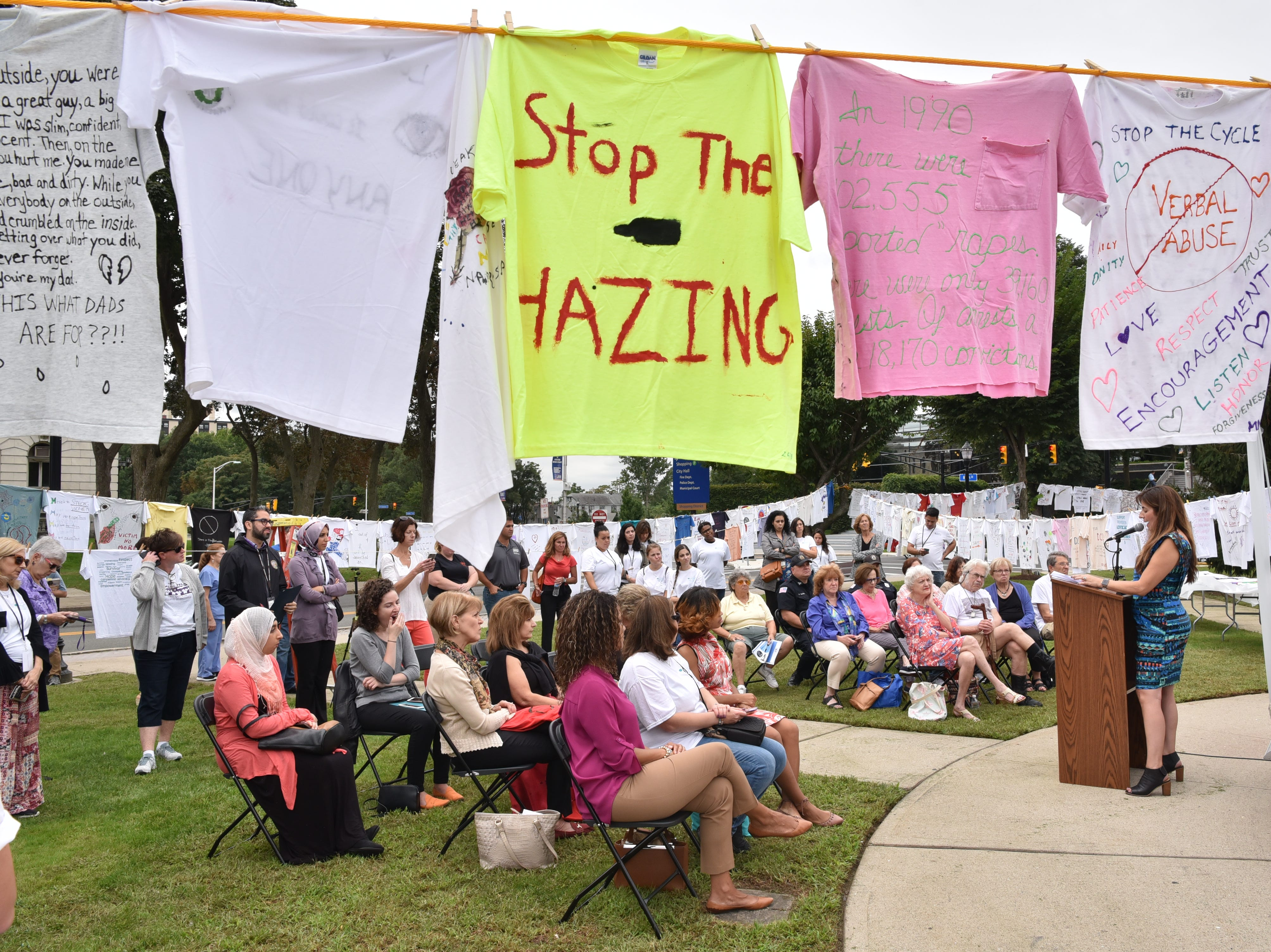 Helen Archontou, CEO of YWCA Bergen County speaks at the 25th Anniversary Clothesline Project on the Green in Hackensack on Thursday, September 20.