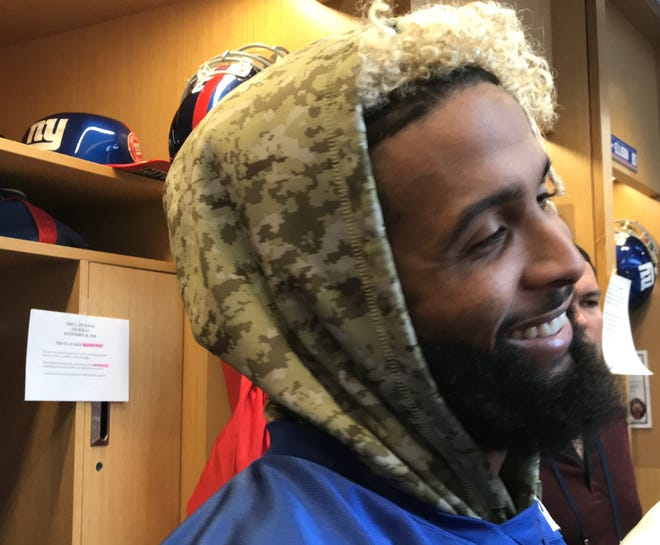 NY Giants wide receiver Odell Beckham Jr. talks to reporters at his locker Thursday prior to the team's practice in East Rutherford, NJ.