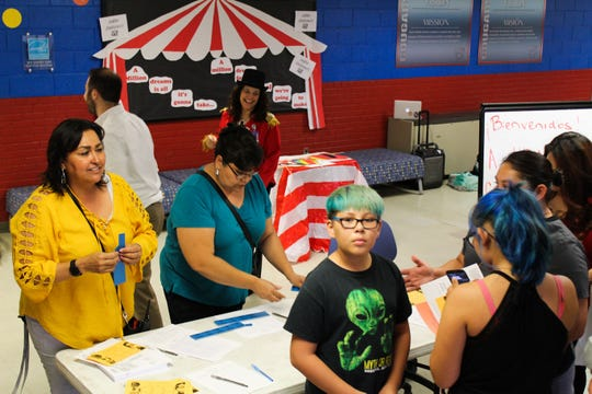 Staff members from Lynn Community Middle School and Mesilla Valley Leadership Academy welcome students and families during an open house event on Wednesday, Sept. 5.