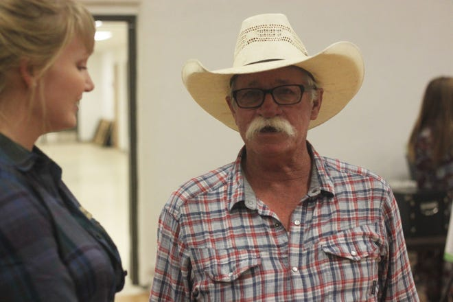 """H.C. """"Hotshot"""" Hendricks explains his needs and concerns as a rancher in the Hope area, Sept. 19, 2018 at the Village of Hope Community Center."""