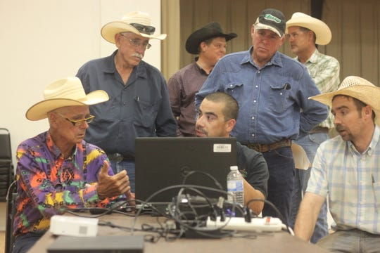Hope ranchers review data from the U.S. Bureau of Land Management's proposed revisions to its Pecos District, which contains Eddy, Lea and Chaves counties, Sept. 19, 2018 at the Hope Community Center.