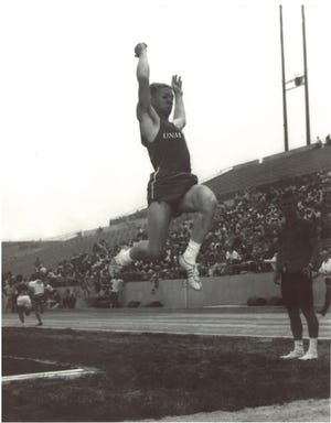 Billy Joe Thompson competes in the long jump at UNM in 1963.