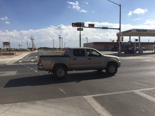 A vehicle passes through the new traffic signal on the intersection of Lea Street and Standpipe Road.