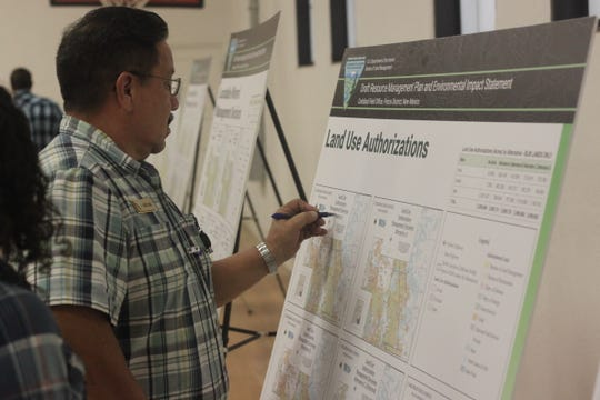 Bureau of Land Management staff discuss revisions to the BLM's resource management plan, Sept. 19, 2018 at the Village of Hope Community Center.