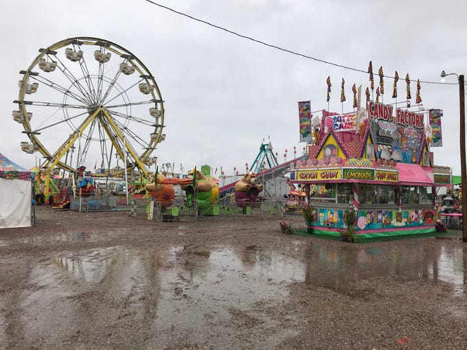 "The rides of the Otero County Fair await thrill-seekers on Thursday after rain poured down on the city for most of the afternoon. One ride operator said most of the rides can still operate in the rain, and that the water adds something to the experience. ""We still have to work,"" he said. ""If people want to come, they'll come. Unless it gets real bad, and then we can go home and relax."""