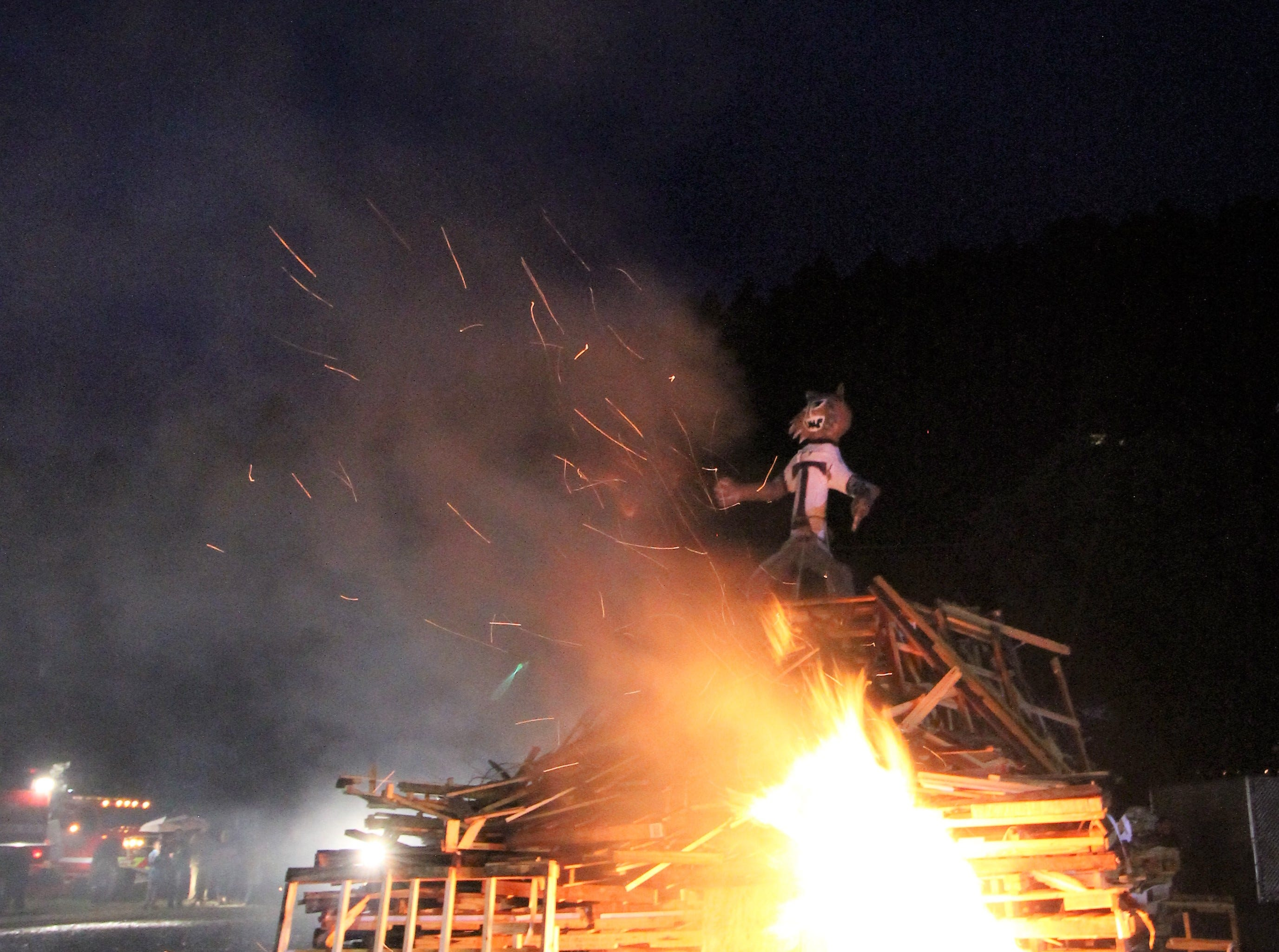 Warriors Homecoming bonfire burning down the Wildcat effigy signifies spirit and the hope for a Warriors win against their rivals, the Tularosa Wildcats.
