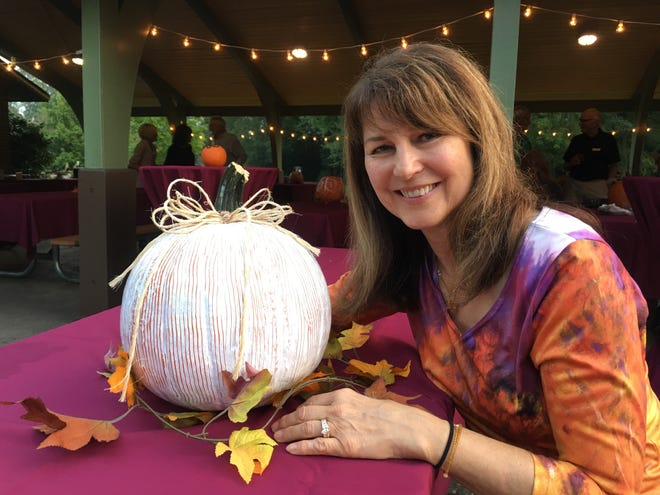 Kathy Jones-Cutler served on the planning committee for the Next 40th anniversary celebration. She decorated pumpkins for attractive centerpieces.