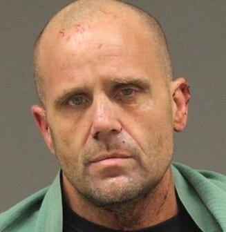 Man arrested in holdup of Northville Township bank