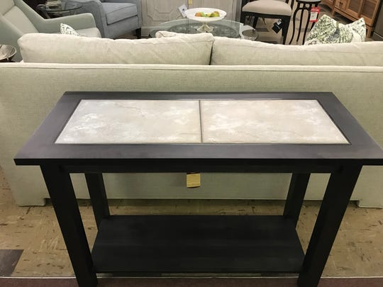 Chris Newell of Livonia-based Chris Furniture donated this sofa table to the Seedlings auction.