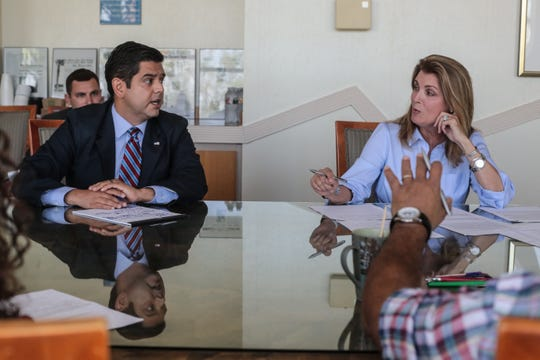 Rep. Raul Ruiz and challenger Kimberlin Brown Pelzer engage each other during The Desert Sun Editorial Board candidate interview session.