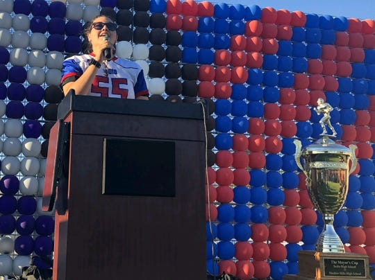Dakota De La Torre, a linebacker for the Indio High School football team, sings the school's alma mater during a town pep rally earlier this year.