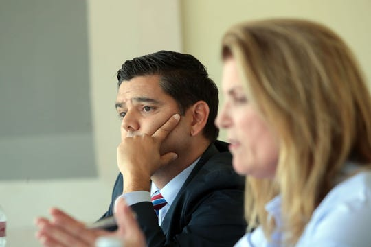 United States 36th House District Democratic congressman Raul Ruiz, M.D. listens to his Republican challenger Kimberlin Brown Pelzer during a meeting of the Desert Sun editorial board on Thursday, September 20, 2018 in Palm Springs.
