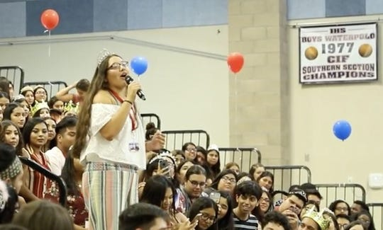 Indio senior Dakota De La Torre sings during a pep rally at school.