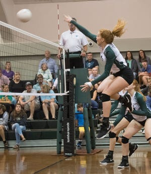Catholic's, Hannah Meyers, (No.17) smashes a set ball during Wednesday's volleyball match against Pace. The Crusaders finished off the Patriots in three-straight games, 25-12, 25-19, 25-23.