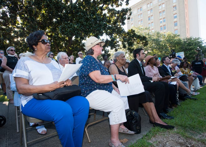 A large crowd assembles in Plaza Ferdinand to witness a Lynching Victim Memorial Ceremony in downtown Pensacola on Thursday, Sept. 20, 2018. Soil from two of the lynching sites in the park was collected during the ceremony.