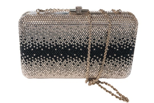 100% champagne and black crystal sparkling Swarovoski crystal pavéd Judith Leiber couture ombre slim slide clutch, donated by Jewelers Trade Shop and valued at $2,995.00.