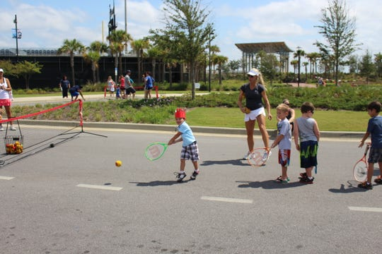 Participants take part in events at a previous 5210 Northwest Florida Day of Play. This year's event is scheduled for Sept. 29.