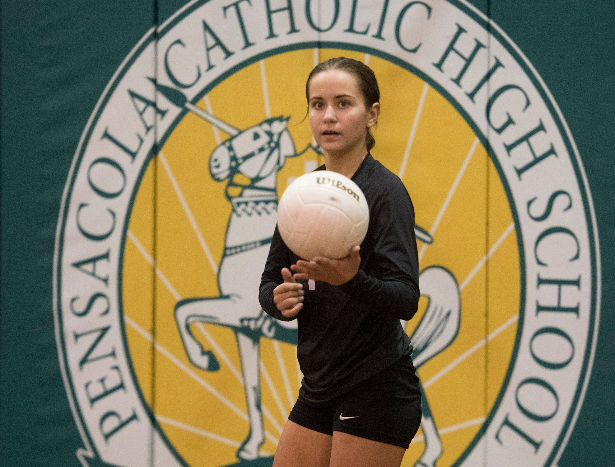 Catholic Freshman, Madison Galloway, (No.1) gets instruction from the sidelines before service during Wednesday's volleyball match against Pace. The Crusaders finished off the Patriots in three-straight games, 25-12, 25-19, 25-23.